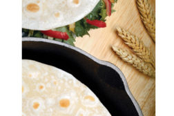 Tortillas in a pan and on table