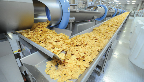 Chips convey on fast-motion vibratory conveyors