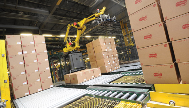 robotic palletizers form pallet loads of product