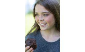 Girl eating muffins