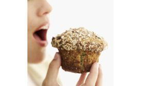 Person eating muffin