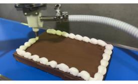 Apex Motion Control Dual Baker-Bot setup for robotic cake decorating